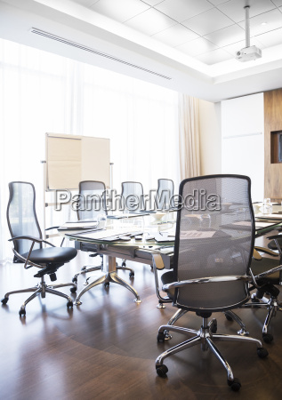 chairs and table in empty conference