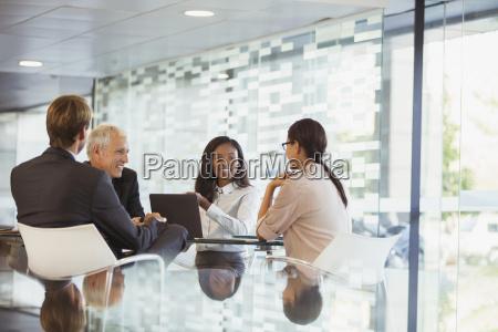 business people talking in meeting in
