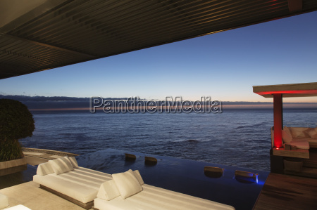sofas and infinity pool overlooking ocean