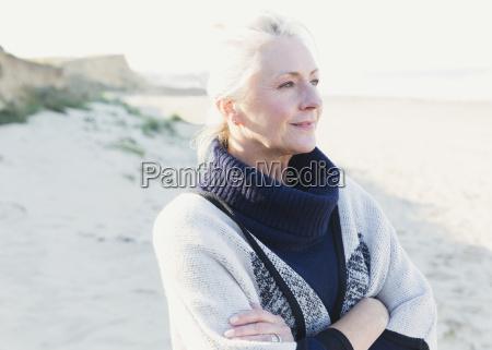pensive senior woman looking away on