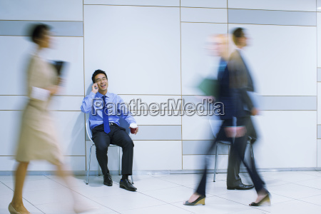 businessman sitting talking on cell phone