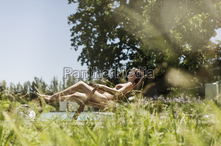 woman relaxing in lounge chair outdoors