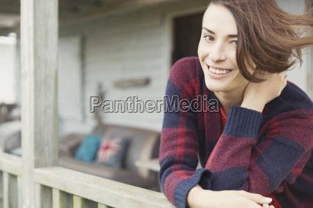 portrait smiling brunette woman on porch
