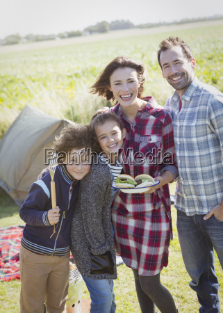 portrait smiling family with barbecued hamburgers