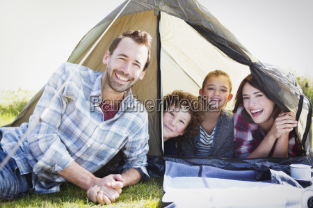 portrait smiling family in tent