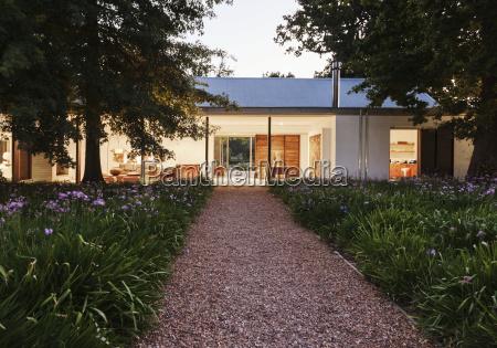gravel walkway leading to modern house
