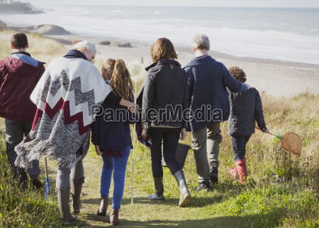 multi generation family walking on sunny