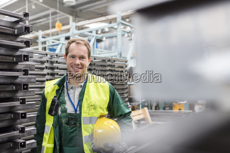 portrait smiling worker in protective workwear