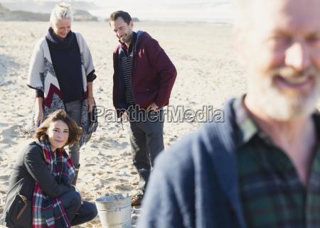 couples, clamming, on, sunny, beach - 17206334