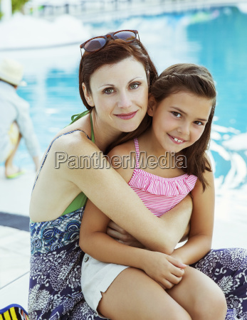portrait of mother and daughter sitting