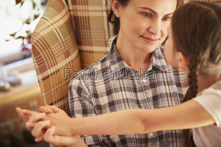 mother and daughter holding hands face