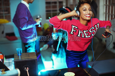 woman playing music and dancing at