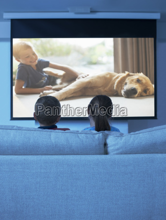children watching television in living room
