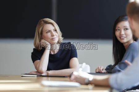 attentive businesswoman listening in meeting