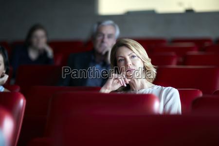 attentive businesswoman listening in seminar audience