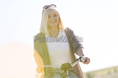 portrait smiling senior woman bike riding