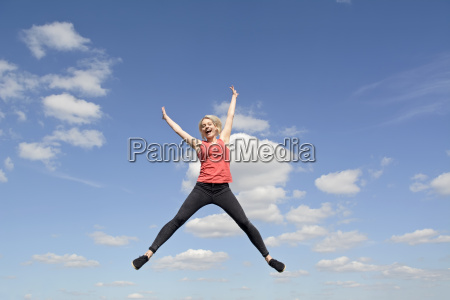 woman makes joy jump