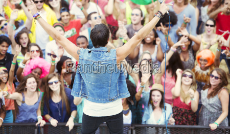 performer facing cheering crowd