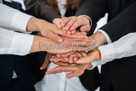 businesspeople hands stacking together