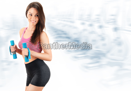young woman with dumbbells physical fitness