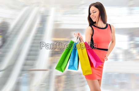 young woman with bags in shopping
