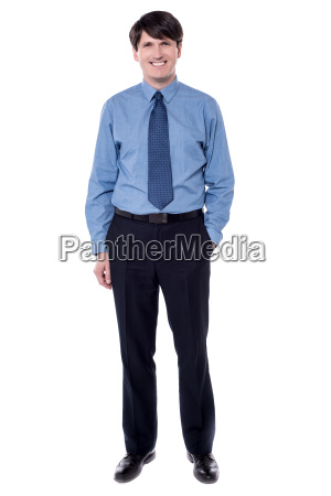businessman posing with his hand in