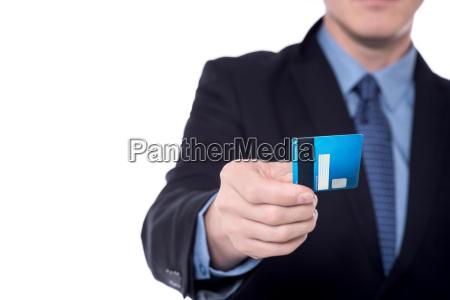 image of businessmans hand holding cash