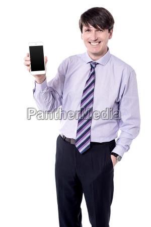 businessman presenting smart phone