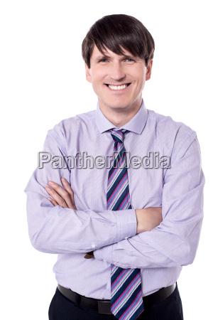 cheerful businessman looking at the camera