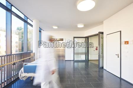 corridor doctor hospital elevator door bed