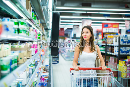 beautiful young woman shopping in a