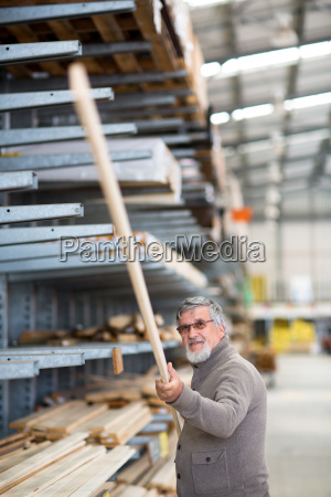 man choosing and buying construction wood