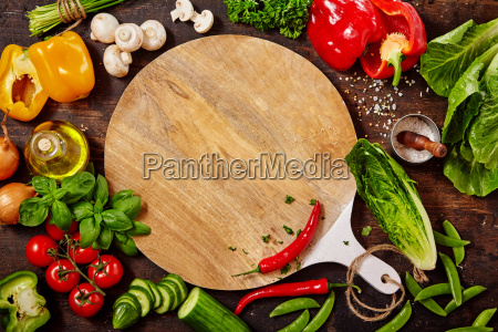 cutting board fresh vegetables and herbs