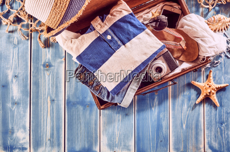 suitcase in seaside vacation themed background