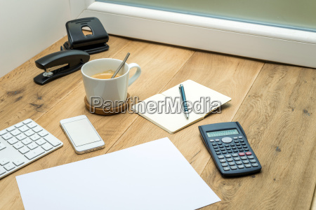 wooden workspace with office supplies and