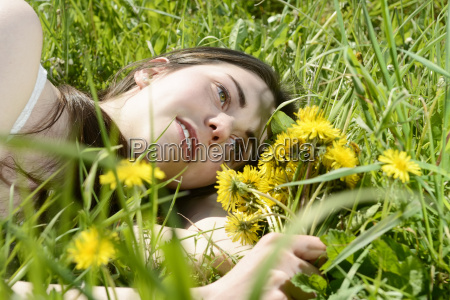 young woman on meadow
