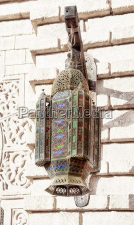 an oriental lamp with ornate ornaments