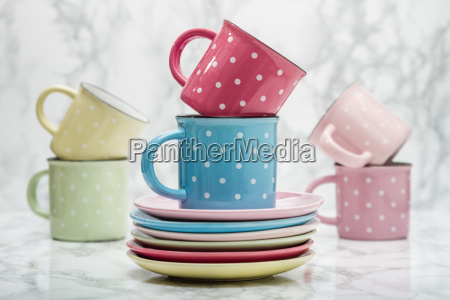 colorful ceramic mugs with white dots