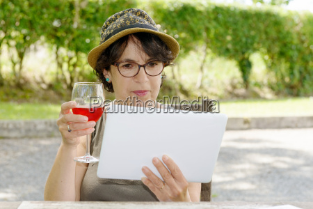 a charming woman with a tablet