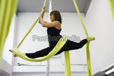 woman doing aerial dance with silks