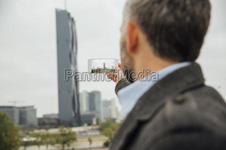 austria vienna businessman taking a picture