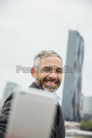 austria vienna businessman taking a selfie