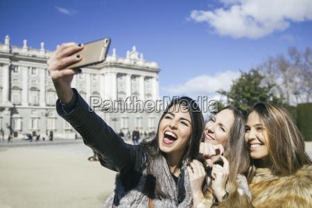 spain madrid three happy women taking
