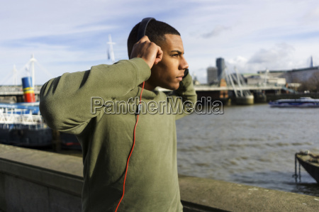 uk london runner listening music at