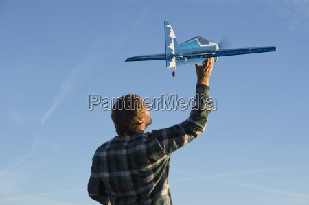 man with model airplane