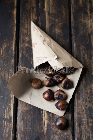 paper bag with roasted chestnuts on