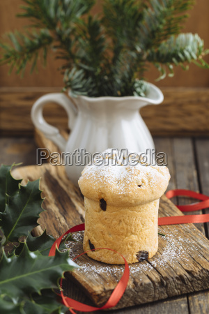 home baked mini panettone on wooden