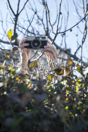 womans hands shooting pictures over a
