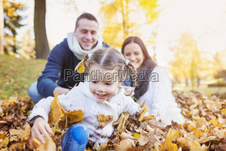 happy family in autumnal park