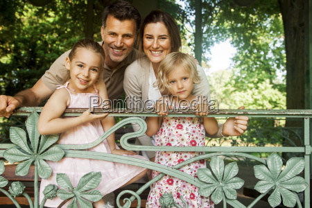 family with two girls standing in